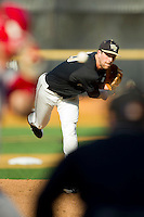 Wake Forest Demon Deacons starting pitcher Justin Van Grouw (30) delivers a pitch to the plate against the North Carolina State Wolfpack at Wake Forest Baseball Park on March 16, 2013 in Winston-Salem, North Carolina.  The Demon Deacons defeated the Wolfpack 13-4.  (Brian Westerholt/Four Seam Images)