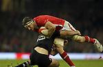 Cardiff, WALES - November 24:.Autumn International.Wales v New Zealand.Wales captain Sam Warburton crashes into Conrad Smith..24.11.12..©Steve Pope - Sportingwales