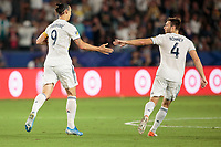 CARSON, CA - SEPTEMBER 15: Zlatan Ibrahimovic #9 and Dave Romney #4 of the Los Angeles Galaxy celebrate a goal during a game between Sporting Kansas City and Los Angeles Galaxy at Dignity Health Sports Complex on September 15, 2019 in Carson, California.