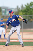 Scott Richmond #59 of the Texas Rangers pitches during a Minor League Spring Training Game against the Kansas City Royals at the Kansas City Royals Spring Training Complex on March 20, 2014 in Surprise, Arizona. (Larry Goren/Four Seam Images)