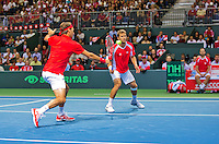 Switserland, Genève, September 19, 2015, Tennis,   Davis Cup, Switserland-Netherlands, Doubles: Swiss team Marco Chiudinelli/Roger Federer (L)<br /> Photo: Tennisimages/Henk Koster