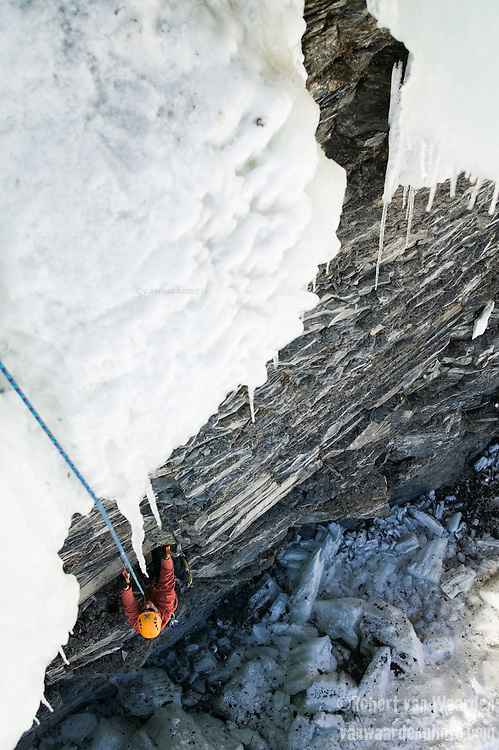 A climber underakes a mixed route in Pont Rouge, Quebec.