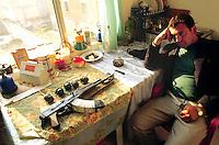 - Albania, armed guard in the factory of an Italian entrepreneur in Valona after the civil war of spring 1997....- Albania, guardia armata nello stabilimento di un imprenditore italiano a Valona  dopo la guerra civile della primavera 1997