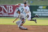 Huntsville Stars second baseman Scooter Gennett #2 leaps over a hard sliding David Nick after making a throw to complete a double play during the Southern League All-Star Game  at Smokies Park on June 19, 2012 in Kodak, Tennessee.  The South Division defeated the North Division 6-2. (Tony Farlow/Four Seam Images).