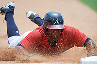 GCL Braves designated hitter Nicholas Vizcaino (19) slides into third base during a game against the GCL Pirates on July 27, 2017 at ESPN Wide World of Sports Complex in Kissimmee, Florida.  GCL Braves defeated the GCL Pirates 8-6.  (Mike Janes/Four Seam Images)