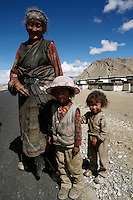 A Tibetan family outside their village on the Friendship Highway which connects Lhasa to Nepal.<br /> Tibet, China.<br /> July, 2007
