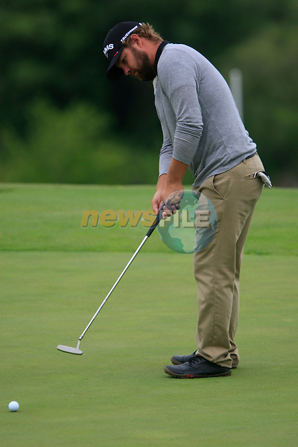 Ryan Moore (USA) takes his putt on the 8th green during Day 2 of the Volvo World Match Play Championship in Finca Cortesin, Casares, Spain, 20th May 2011. (Photo Eoin Clarke/Golffile 2011)