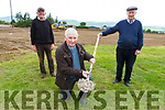George McKenna front shows off the Mussel shell drain that himself JP O'Sullivan left and Jack Kearin worked of decades ago that was uncovered during the recent works on Milltown Castlemaine GAA pitch