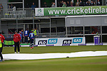 The Covers being put in place as the rain becomes more unpleasant as the rain drops start to fall at the Ireland v England One Day Cricket International held at Malahide Cricket Club, Dublin, Ireland. 8th May 2015.<br /> Photo: Joe Curtis/www.newsfile.ie