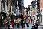Great Britain, England, Hampshire, Winchester: View of shops and shoppers along Winchesters old High Street