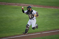 Idaho Falls Chukars catcher Jesus Atencio (31) chases a runner down the third base line during a Pioneer League game against the Great Falls Voyagers at Melaleuca Field on August 18, 2018 in Idaho Falls, Idaho. The Idaho Falls Chukars defeated the Great Falls Voyagers by a score of 6-5. (Zachary Lucy/Four Seam Images)