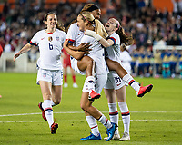 HOUSTON, TX - JANUARY 31: Jessica McDonald #14, Rose Lavelle #16, Andi Sullivan and Lindsey Horan #9 of the USA celebrate a goal during a game between Panama and USWNT at BBVA Stadium on January 31, 2020 in Houston, Texas.