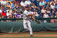 Louisiana State third baseman Christian Ibarra (14) makes a throw to first base against the North Carolina Tar Heels during Game 7 of the 2013 Men's College World Series on June 18, 2013 at TD Ameritrade Park in Omaha, Nebraska. The Tar Heels defeated the Tigers 4-2, eliminating LSU from the tournament. (Andrew Woolley/Four Seam Images)