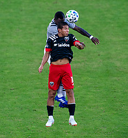 WASHINGTON, DC - NOVEMBER 8: Edison Flores #10 of D.C. United and Zachary Brault-Guillard #15 of the Montreal Impact head the ball during a game between Montreal Impact and D.C. United at Audi Field on November 8, 2020 in Washington, DC.