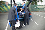 Bangor City 0 FC Honka 1, 23/07/2009. Racecourse Ground, Europa League. Bangor City's physio and kit man unloading equipment from a car outside Wrexham's Racecourse Ground, the venue for their sides Europa League second round second leg tie against FC Honka from Finland. The match had to be staged away from City's Farrar Road ground as it did not meet UEFA's stadium standards. The Finns won 1-0 in Wales to go through 3-0 on aggregate in front of 602 spectators in the first season of the newly-introduced competition which replaced the UEFA Cup. Photo by Colin McPherson.