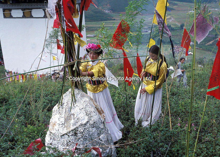 "Mosuo women leave offerings at the shrine of the goddess Ganmo during the annual fertility festival in Yunnan.Women from the Mosuo tribe do not marry, take as many lovers as they wish and have no word for ""father"" or ""husband"". But the arrival of tourism and the sex industry is changing their culture...PHOTO BY SINOPIX"
