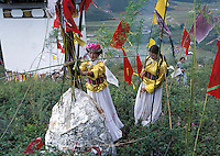 """Mosuo women leave offerings at the shrine of the goddess Ganmo during the annual fertility festival in Yunnan.Women from the Mosuo tribe do not marry, take as many lovers as they wish and have no word for """"father"""" or """"husband"""". But the arrival of tourism and the sex industry is changing their culture...PHOTO BY SINOPIX"""