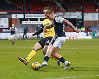 20th February 2021; Dens Park, Dundee, Scotland; Scottish Championship Football, Dundee FC versus Queen of the South; Jason Cummings of Dundee takes on Gregor Buchanan of Queen of the South