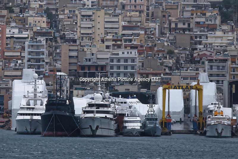 Border Control vessel HMC Valiant (5th L) by a shipyard in the Perama area of Piraeus, Greece. Thursday 03 January 2019
