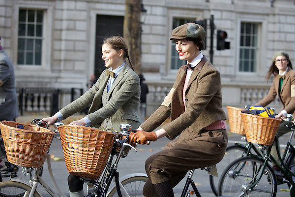 Erin O'Connor and a model bicycle down Whitehall during The Tweed Run