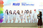 A billboard of Japanese girl group NiziU is seen at a train station in Tokyo, Japan on December 3, 2020. (Photo by Naoki Nishimura/AFLO)