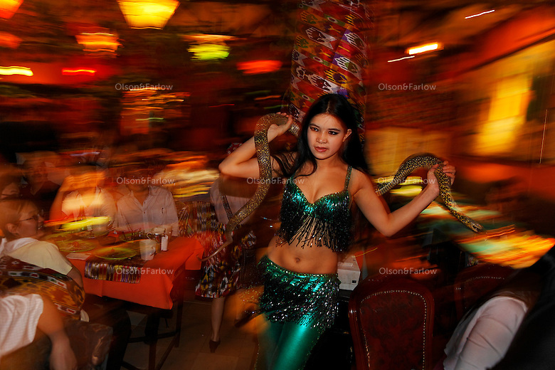A Fun Ti Carnival Restaurant... Ethnic restaurant... dancers, wait staff, performers are all from Xinjiang Province in North West China.  Contact number is +86 65272288 and manager is Yangmei mobile is 133 1121 1814..yangmeimei77@126.com.Address is No. Jia 2, Hou Guai Bang Hudong, No. 188 Chaonei Street, Dongcheng District, Beijing 100010..Fixer Contact is Evelyn +86 137 1896 4824