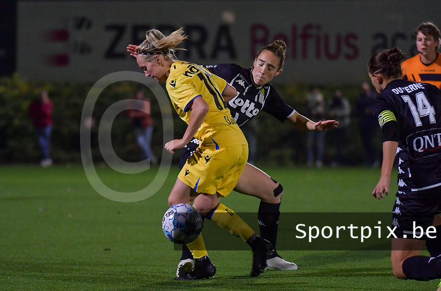 Celien Guns (10) of Club Brugge pictured fighting for the ball with Hanne Hellinx (3) of Sporting Charleroi during a female soccer game between Sporting Charleroi and Club Brugge YLA on the sixth matchday in the 2021 - 2022 season of Belgian Scooore Womens Super League , friday 8 October 2021 in Marcinelle , Belgium . PHOTO SPORTPIX | STIJN AUDOOREN
