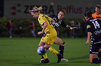 Celien Guns (10) of Club Brugge pictured fighting for the ball with Hanne Hellinx (3) of Sporting Charleroi during a female soccer game between Sporting Charleroi and Club Brugge YLA on the sixth matchday in the 2021 - 2022 season of Belgian Scooore Womens Super League , friday 8 October 2021 in Marcinelle , Belgium . PHOTO SPORTPIX   STIJN AUDOOREN