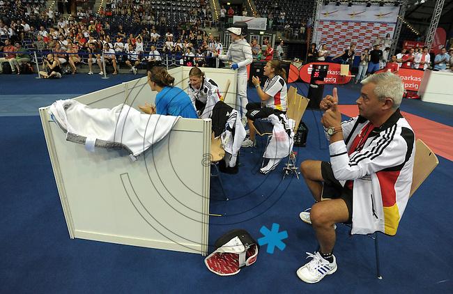 European Championships Fencing 2010 / Fecht Europameisterschaft 2010 in Leipzig - Competition Championat d'europe - im Bild: womens foil team - the German national coach Lajos Somodi (r.) nervous and excited during the semi finale against Russian team   . Foto: Norman Rembarz..Norman Rembarz , Autorennummer 41043728 , Augustenstr. 2, 04317 Leipzig, Tel.: 01794887569, Hypovereinsbank: BLZ: 86020086, KN: 357889472, St.Nr.: 231/261/06432 - Jegliche kommerzielle Nutzung ist honorar- und mehrwertsteuerpflichtig! Persönlichkeitsrechte sind zu wahren. Es wird keine Haftung übernommen bei Verletzung von Rechten Dritter. Autoren-Nennung gem. §13 UrhGes. wird verlangt. Weitergabe an Dritte nur nach  vorheriger Absprache..