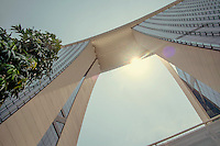 A view from the ground of the Sky Park swimming pool, on the top of the three skyscraper structure of the Marina Bay Sands resort hotel.