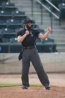 Home plate umpire Matt Herrera calls a batter out on strikes during a Pioneer League game between the Missoula Osprey and the Orem Owlz at Ogren Park Allegiance Field on August 19, 2018 in Missoula, Montana. The Missoula Osprey defeated the Orem Owlz by a score of 8-0. (Zachary Lucy/Four Seam Images)