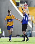 Mark McInerney of Clare gets a yellow card during their Munster Minor football final at Pairc Ui Chaoimh. Photograph by John Kelly.