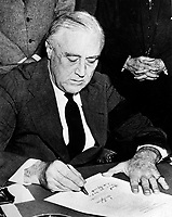 President Franklin D. Rossevelt signing the declaration of war against Japan, December 8, 1941.  (National Park Service)<br /> NARA FILE #:  079-AR-82<br /> WAR & CONFLICT BOOK #:  743