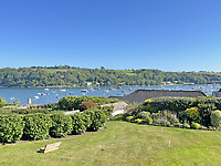 BNPS.co.uk (01202) 558833. <br /> Pic: LillicrapChilcott/BNPS<br /> <br /> Pictured: Gardens. <br /> <br /> This impressive waterfront home with breath-taking views is the perfect property for a wannabe sailor - on the market for £2.5m.<br /> <br /> Huefield sits in an elevated position looking over the rooftops of neighbouring properties onto the beautiful Helford River in Cornwall - ideal for watching boats coming and going.<br /> <br /> The Helford Passage area is so sought after houses rarely come up for sale and this one, on the market with Lillicrap Chilcott, is the only property available there at the moment.<br /> <br /> The five-bedroom home is south facing and has a swimming pool and beautiful gardens for enjoying the view, as well as access to a gate with a right of way down to the water.