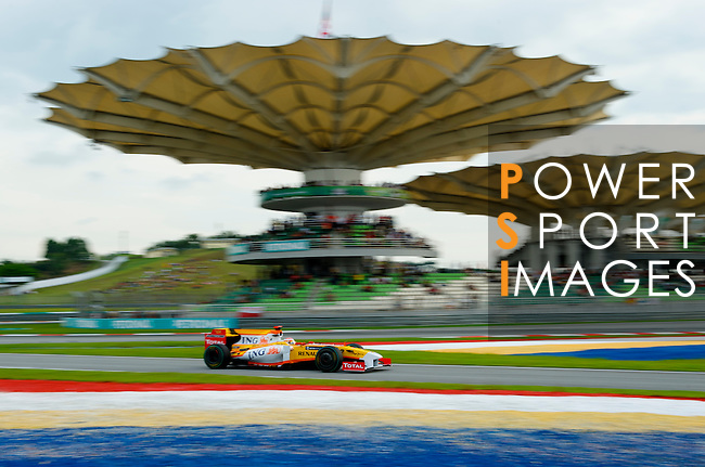04 Apr 2009, Kuala Lumpur, Malaysia --- ING Renault F1 Team driver Fernando Alonso of Spain steers his car during the third practice session ahead the 2009 Fia Formula One Malasyan Grand Prix at the Sepang circuit near Kuala Lumpur. Photo by Victor Fraile --- Image by © Victor Fraile / The Power of Sport Images