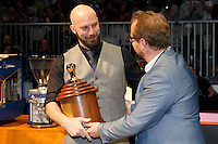 MELBOURNE, 26 MAY - Pete LICATA from USA receives the winners trophy from Carl Sara after  being announced as the winner of the the 2013 World Barista Championship held at the Melbourne Show Grounds in Melbourne, Australia. Licata won in a field of national champion baristas from 53 countries. Photo Sydney Low / syd-low.com