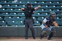 Home plate umpire John Budka calls a batter out on strikes during the Carolina League game between the Lynchburg Hillcats and the Winston-Salem Dash at BB&T Ballpark on May 9, 2019 in Winston-Salem, North Carolina. The Dash defeated the Hillcats 4-1. (Brian Westerholt/Four Seam Images)