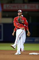 Washington Nationals second baseman Luis García (2) reacts after being unable to complete a throw to first during a Major League Spring Training game against the Miami Marlins on March 20, 2021 at FITTEAM Ballpark of the Palm Beaches in Palm Beach, Florida.  (Mike Janes/Four Seam Images)