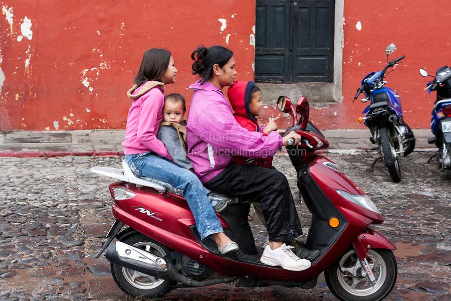 Antigua, Guatemala.  Mother on Motorbike with Three Children.