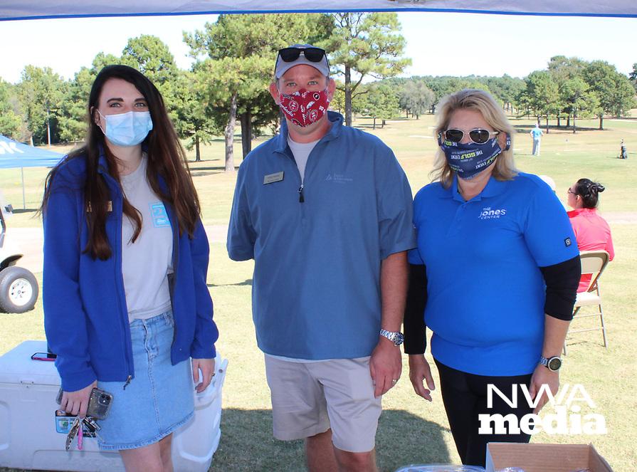 Ali Taylor (from left), Chris Sooter and Zelda Parson volunteer at The Jones Center golf benefit.<br /> (NWA Democrat-Gazette/Carin Schoppmeyer)