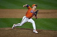 Pitcher Ryley Gilliam (44) of the Clemson Tigers delivers a pitch in a game against the William and Mary Tribe on February 16, 2018, at Doug Kingsmore Stadium in Clemson, South Carolina. Clemson won, 5-4 in 10 innings. (Tom Priddy/Four Seam Images)