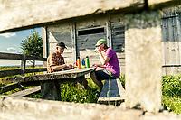 Hikers enjoy traditional Swedish fika along the Pilgrimsleden trail, West Sweden, Sweden - Västsverige, Sverige