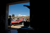 Clear skies and sunny weather had some people searching for shade to cool off during the car show portion of the 'Lost in the Fifties' weekend in Sandpoint, ID. According to car show officials, 602 cars entered the contest--one of the highest number of entrants in the weekend's 25 year history... (©Matt Mills McKnight/2010)