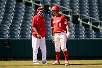 Alex Ulloa (8) talks with the third base coach during the Baseball Factory All-Star Classic at Dr. Pepper Ballpark on October 4, 2020 in Frisco, Texas.  Alex Ulloa (8), a resident of Culter Bay, Florida, attends Calvary Christian Academy.  (Ken Murphy/Four Seam Images)