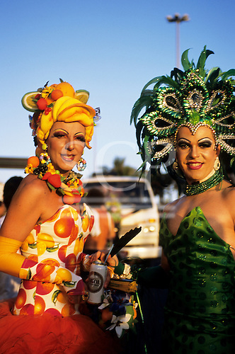 Rio de Janeiro, Brazil. Carnival; Banda de Ipanema, traditional gay street parade. Two transvestites in glorious costumes.