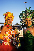 Rio de Janeiro, Brazil. Carnival; Banda de Ipanema, traditional gay street parade. Two transvestites in glorious costumes.