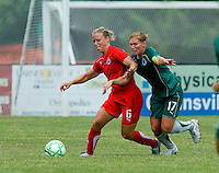Washington Freedom midfielder Lori Lindsey (6) is pressured by St. Louis Athletica midfielder Lori Chalupny (17) during a WPS match at Anheuser-Busch Soccer Park, in Fenton, MO, June 20 2009. Washington  won the match 1-0.