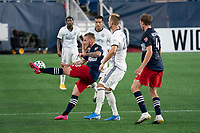 FOXBOROUGH, UNITED STATES - AUGUST 20: Alexander Buttner #28 of New England Revolution passes the ball down the field during a game between Philadelphia Union and New England Revolution at Gilette on August 20, 2020 in Foxborough, Massachusetts.