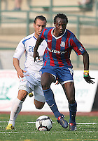 Mathew Mbuta #14 of Crystal Palace Baltimore shields the ball from Antonio Ribeiro #26 of the Montreal Impact during an NASL match at Paul Angelo Russo Stadium in Towson, Maryland on August 21 2010. Montreal won 5-0.
