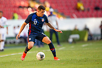GUADALAJARA, MEXICO - MARCH 28: Aaron Herrera #17 of the United States moves with the ball during a game between Honduras and USMNT U-23 at Estadio Jalisco on March 28, 2021 in Guadalajara, Mexico.